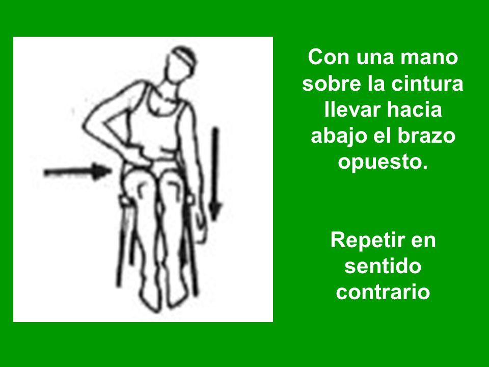 Con una mano sobre la cintura llevar hacia abajo el brazo opuesto.