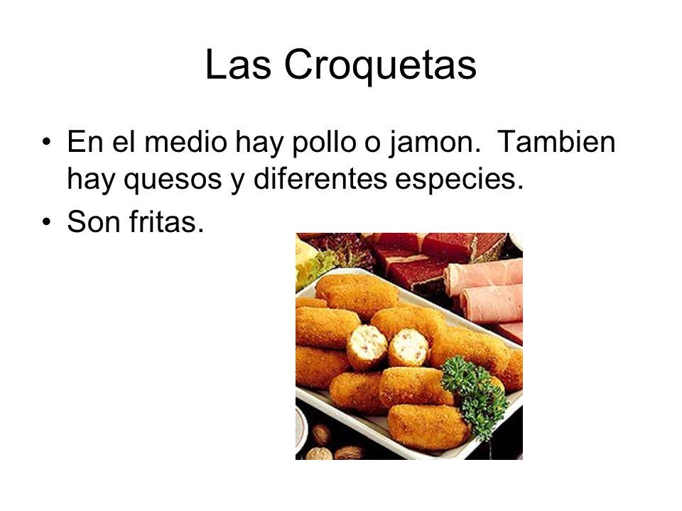 Las Croquetas En el medio hay pollo o jamon. Tambien hay quesos y diferentes especies. Son fritas.