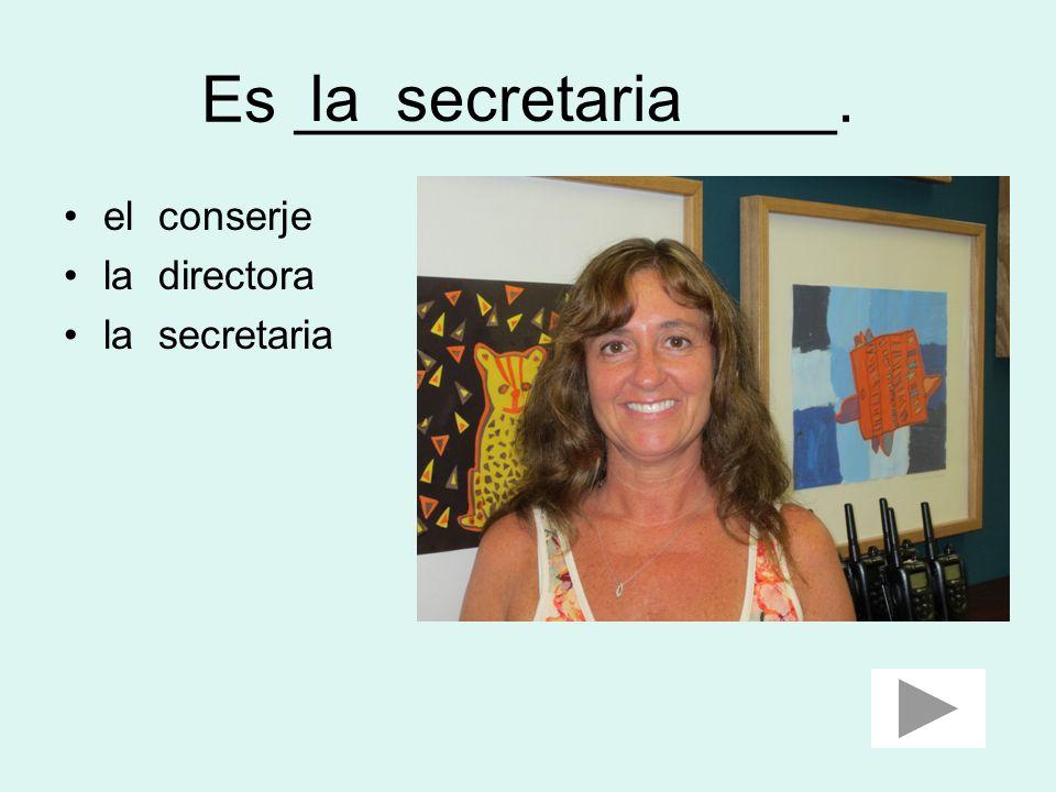 Es _______________. la secretaria el conserje la directora