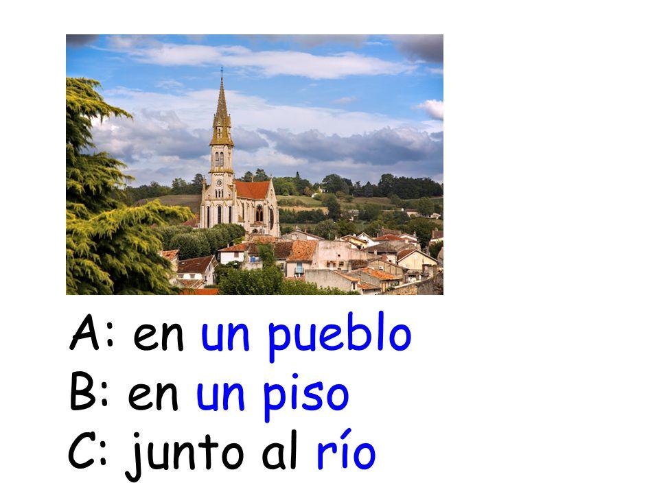 A: en un pueblo B: en un piso C: junto al río