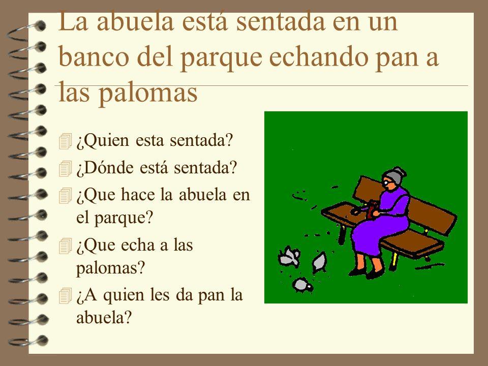 La abuela está sentada en un banco del parque echando pan a las palomas