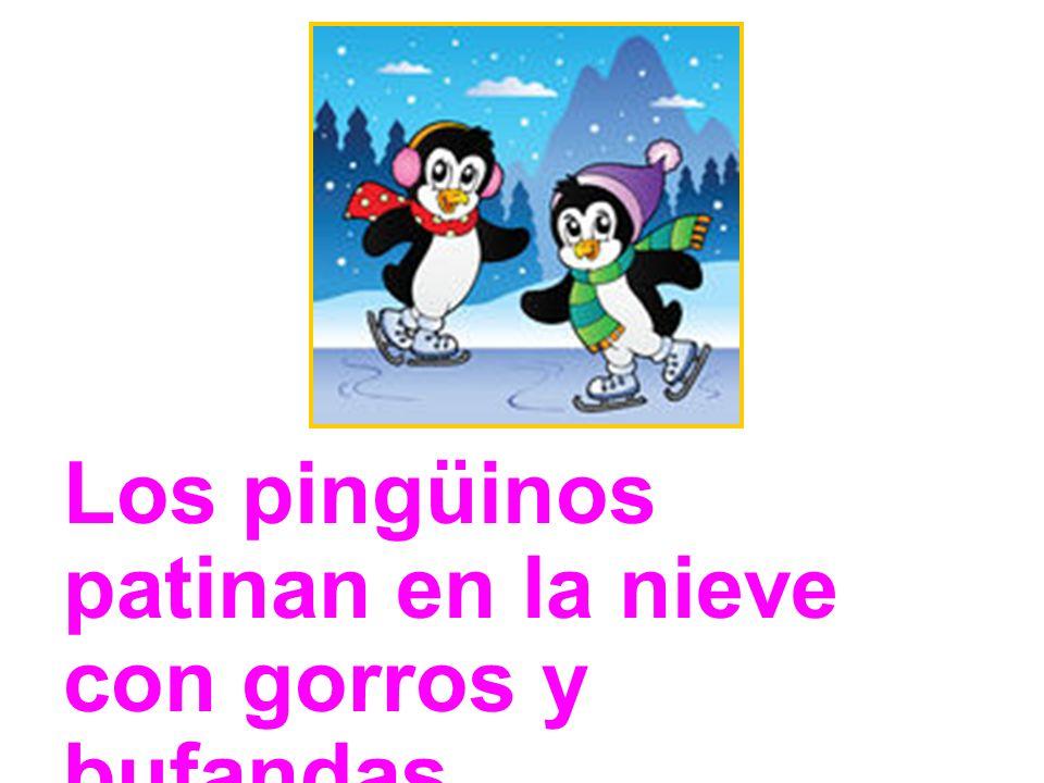 Los pingüinos patinan en la nieve con gorros y bufandas