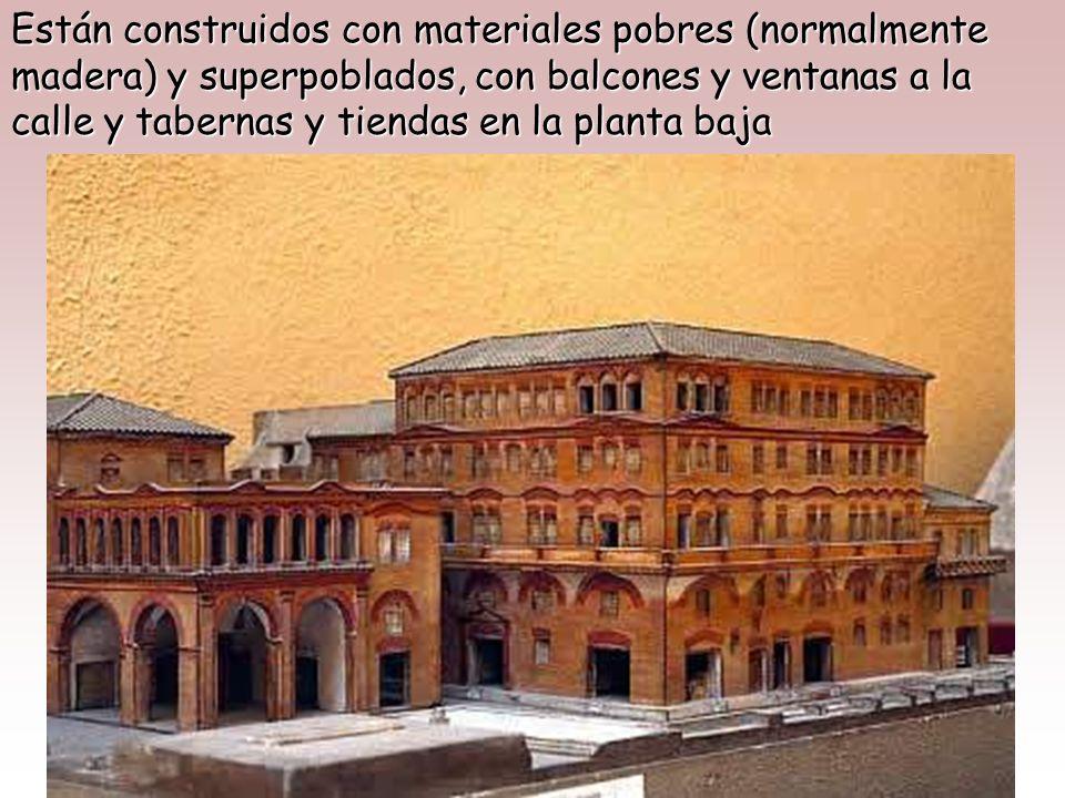 Están construidos con materiales pobres (normalmente madera) y superpoblados, con balcones y ventanas a la calle y tabernas y tiendas en la planta baja
