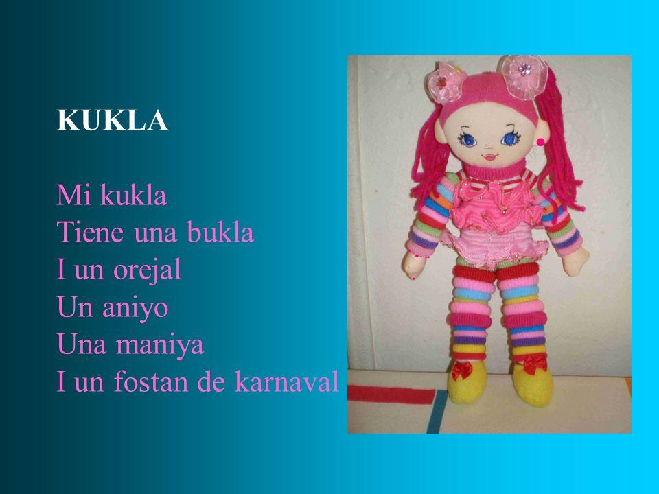 KUKLA Mi kukla Tiene una bukla I un orejal Un aniyo Una maniya I un fostan de karnaval