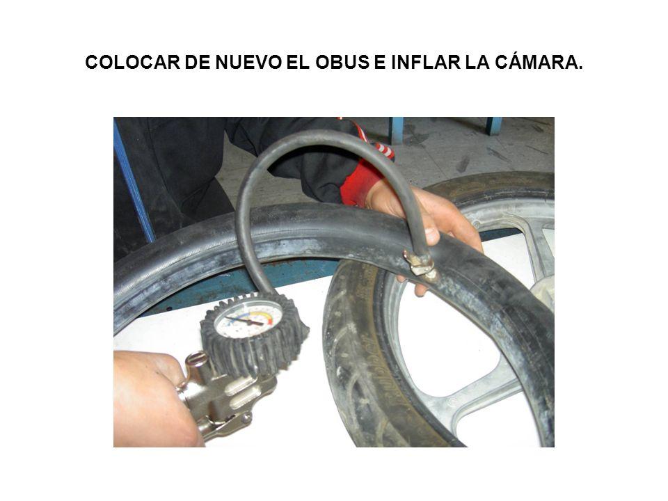 COLOCAR DE NUEVO EL OBUS E INFLAR LA CÁMARA.
