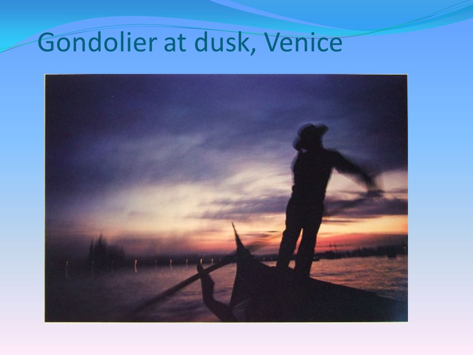 Gondolier at dusk, Venice