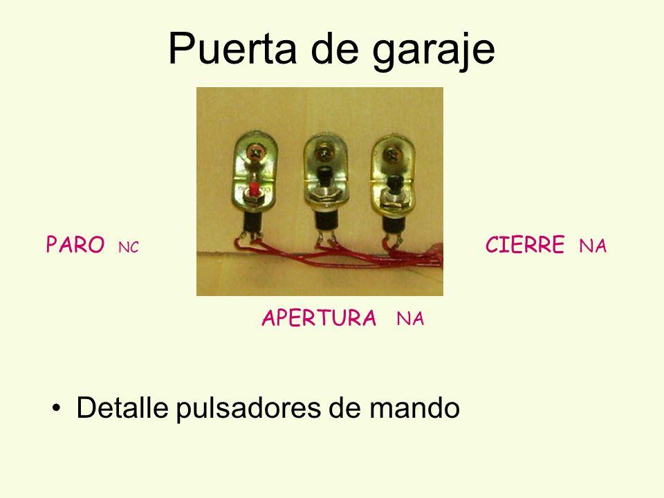 Puerta de garaje Detalle pulsadores de mando PARO NC CIERRE NA