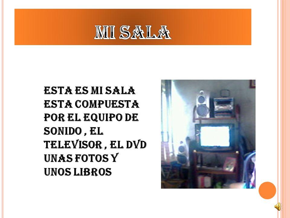 Mi sala Esta es mi sala esta compuesta por el equipo de sonido , el televisor , el DVD unas fotos y unos libros.