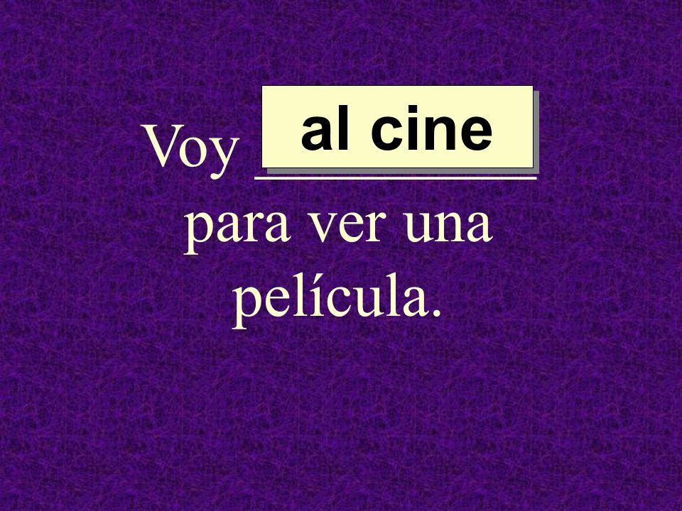 Voy _________ para ver una película.