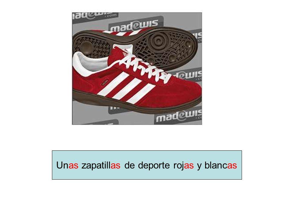Unas zapatillas de deporte rojas y blancas
