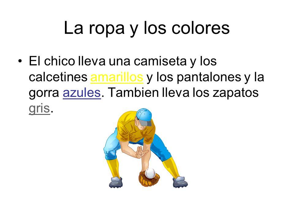 La ropa y los colores El chico lleva una camiseta y los calcetines amarillos y los pantalones y la gorra azules.