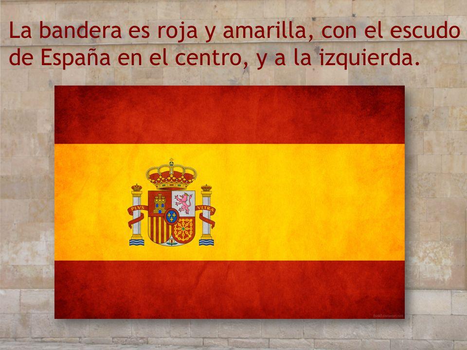 La bandera es roja y amarilla, con el escudo de España en el centro, y a la izquierda.
