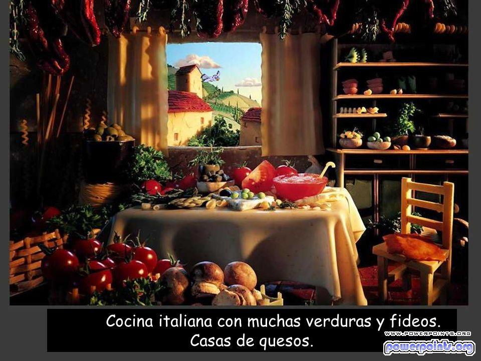 Cocina italiana con muchas verduras y fideos. Casas de quesos.