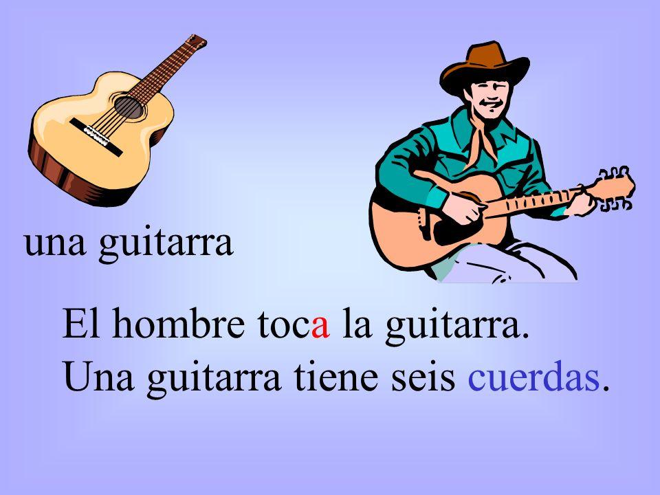 una guitarra El hombre toca la guitarra. Una guitarra tiene seis cuerdas.