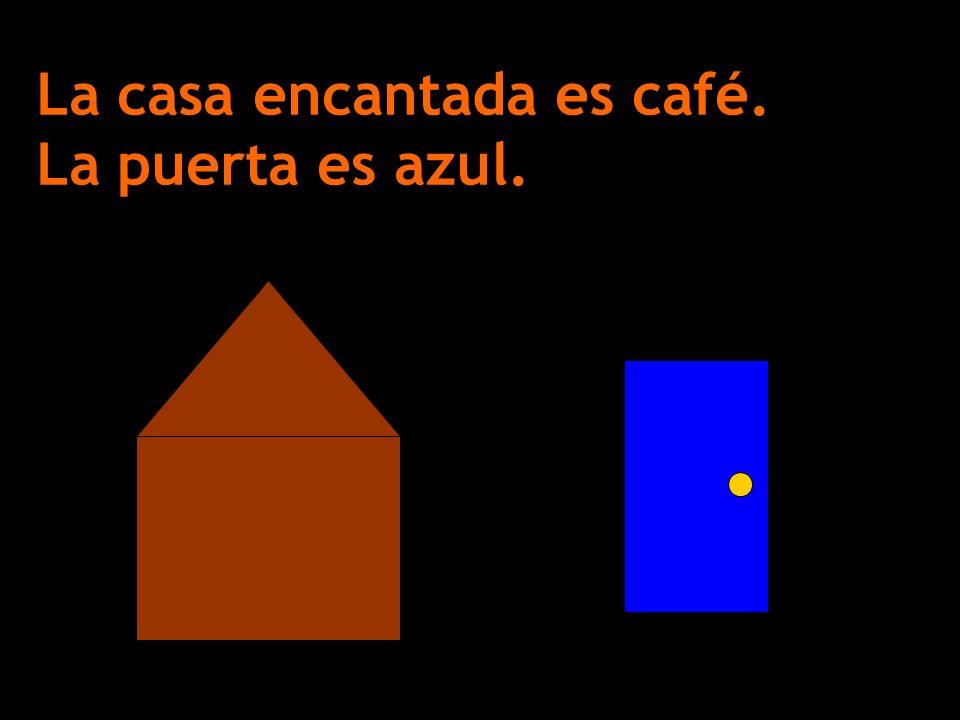 La casa encantada es café. La puerta es azul.