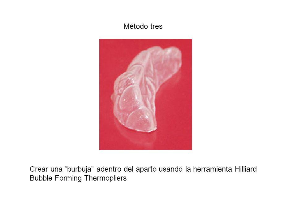 Método tres Crear una burbuja adentro del aparto usando la herramienta Hilliard Bubble Forming Thermopliers.