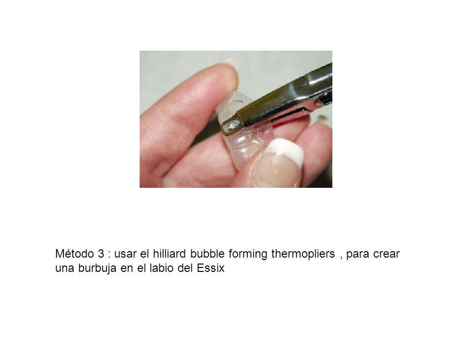 Método 3 : usar el hilliard bubble forming thermopliers , para crear una burbuja en el labio del Essix