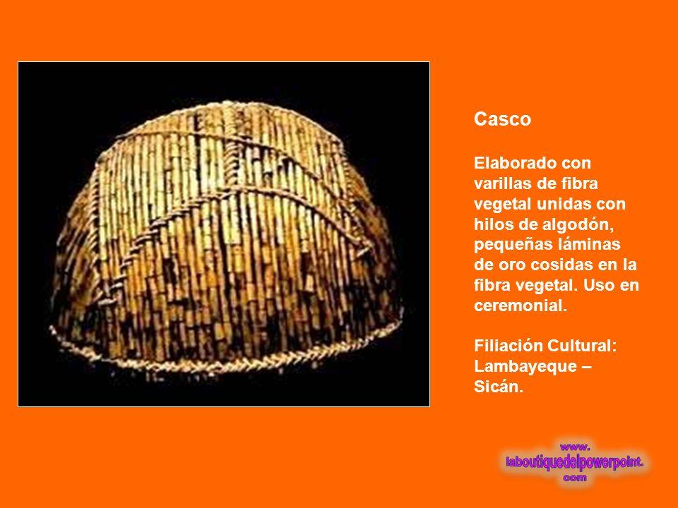 Casco Elaborado con varillas de fibra vegetal unidas con hilos de algodón, pequeñas láminas de oro cosidas en la fibra vegetal. Uso en ceremonial.