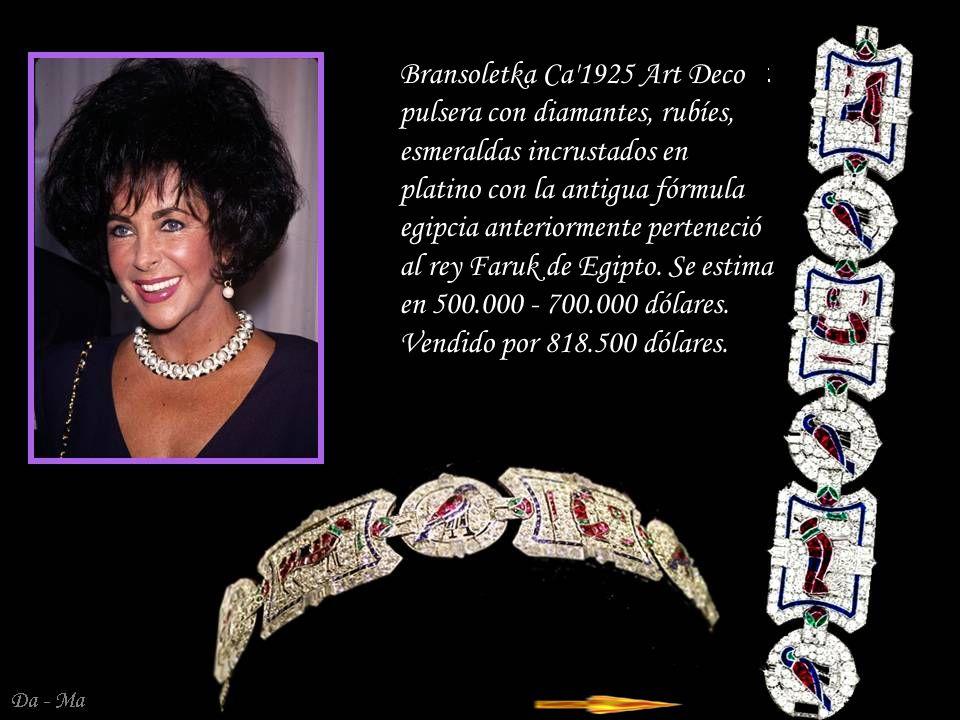 Bransoletka Ca 1925 Art Deco pulsera con diamantes, rubíes, esmeraldas incrustados en platino con la antigua fórmula egipcia anteriormente perteneció al rey Faruk de Egipto. Se estima en 500.000 - 700.000 dólares. Vendido por 818.500 dólares.