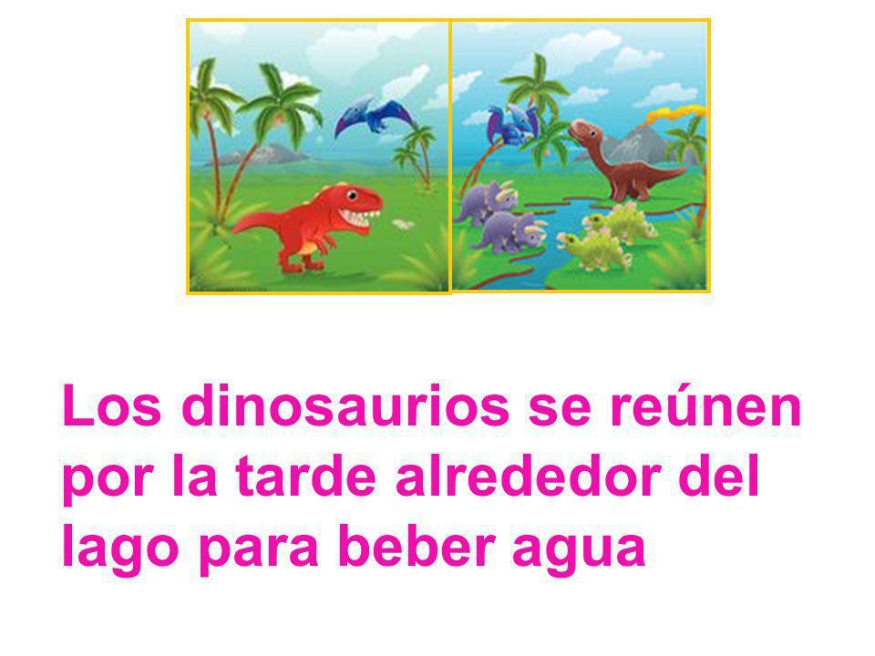 Los dinosaurios se reúnen por la tarde alrededor del lago para beber agua