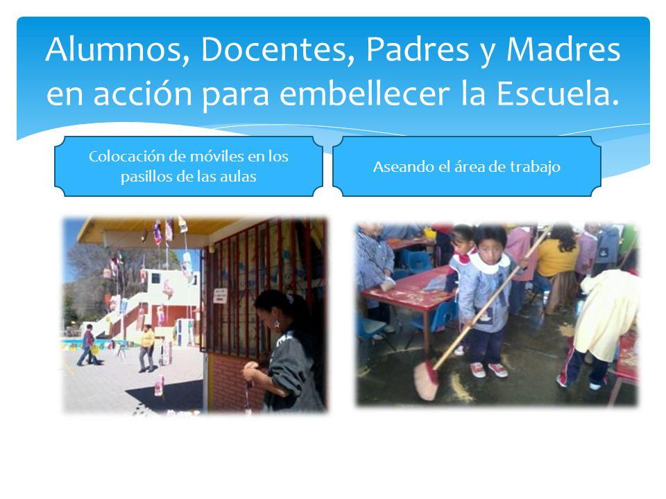 Alumnos, Docentes, Padres y Madres en acción para embellecer la Escuela.