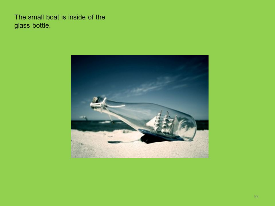 The small boat is inside of the glass bottle.