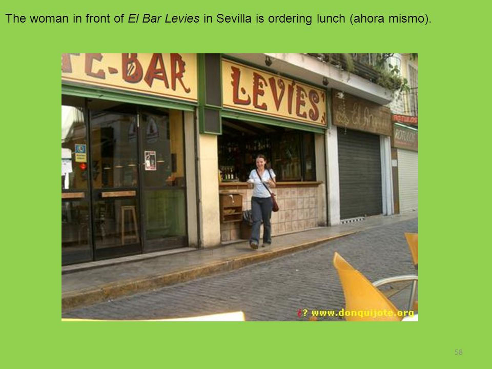 The woman in front of El Bar Levies in Sevilla is ordering lunch (ahora mismo).