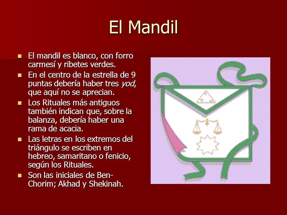 El Mandil El mandil es blanco, con forro carmesí y ribetes verdes.