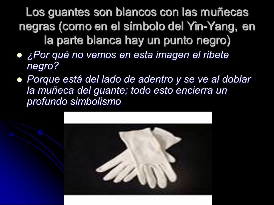 Los guantes son blancos con las muñecas negras (como en el símbolo del Yin-Yang, en la parte blanca hay un punto negro)