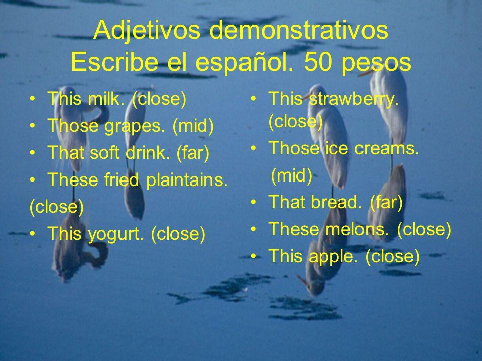 Adjetivos demonstrativos Escribe el español. 50 pesos