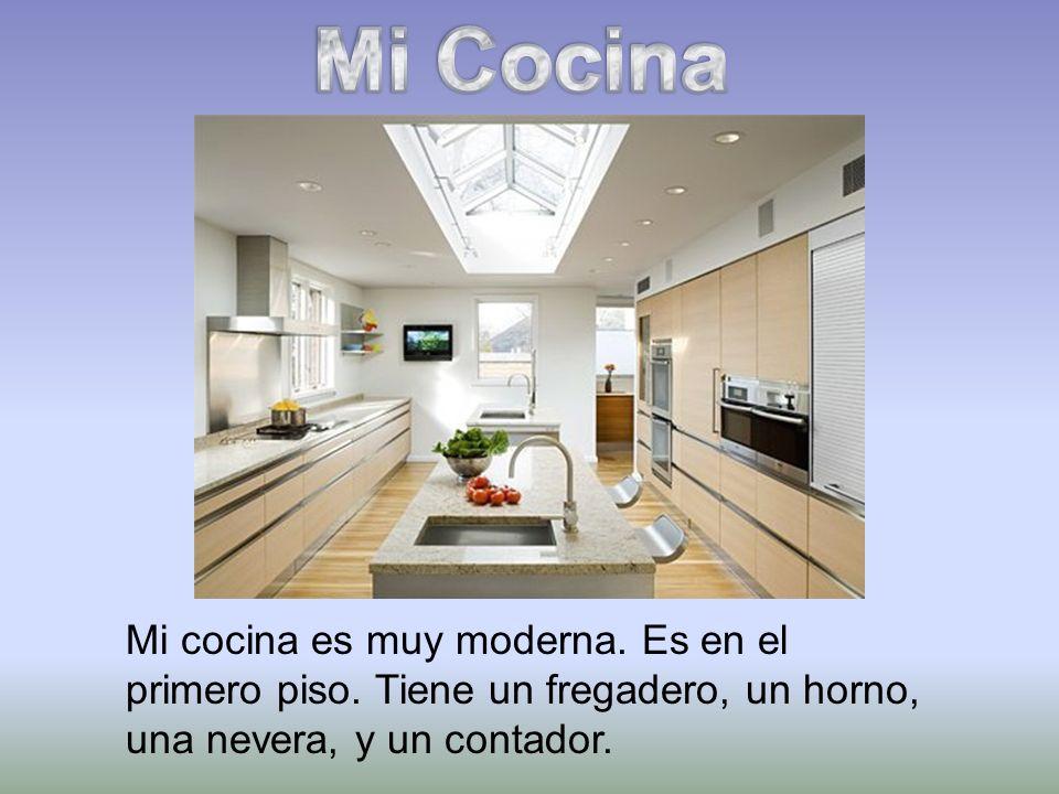 Mi Cocina Mi cocina es muy moderna. Es en el primero piso.