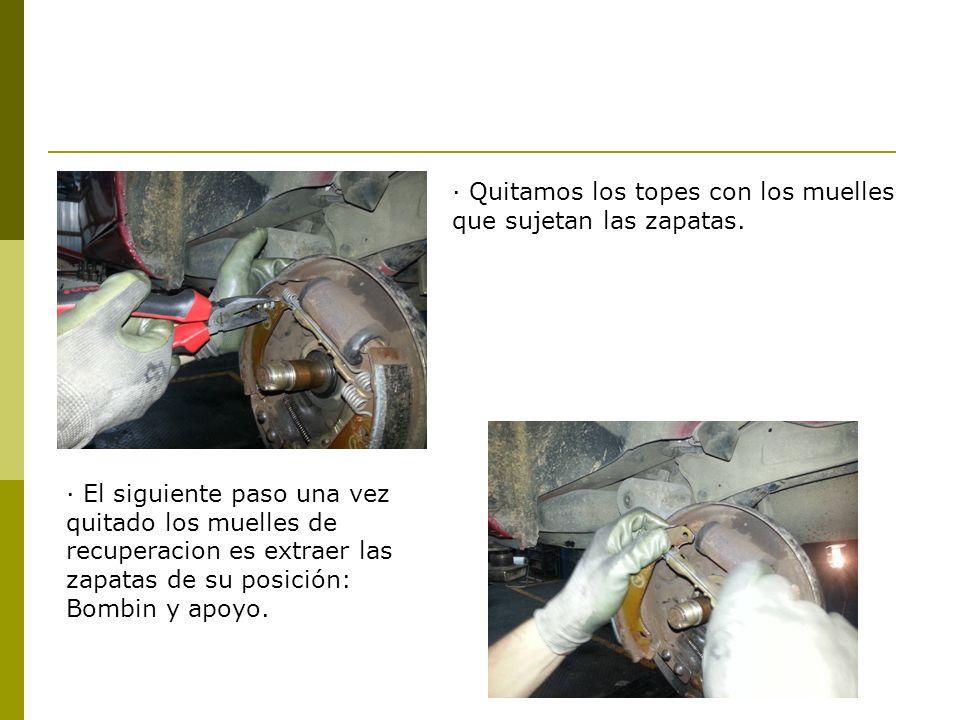 · Quitamos los topes con los muelles que sujetan las zapatas.