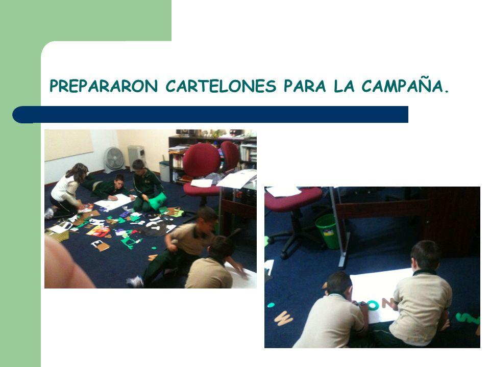 PREPARARON CARTELONES PARA LA CAMPAÑA.