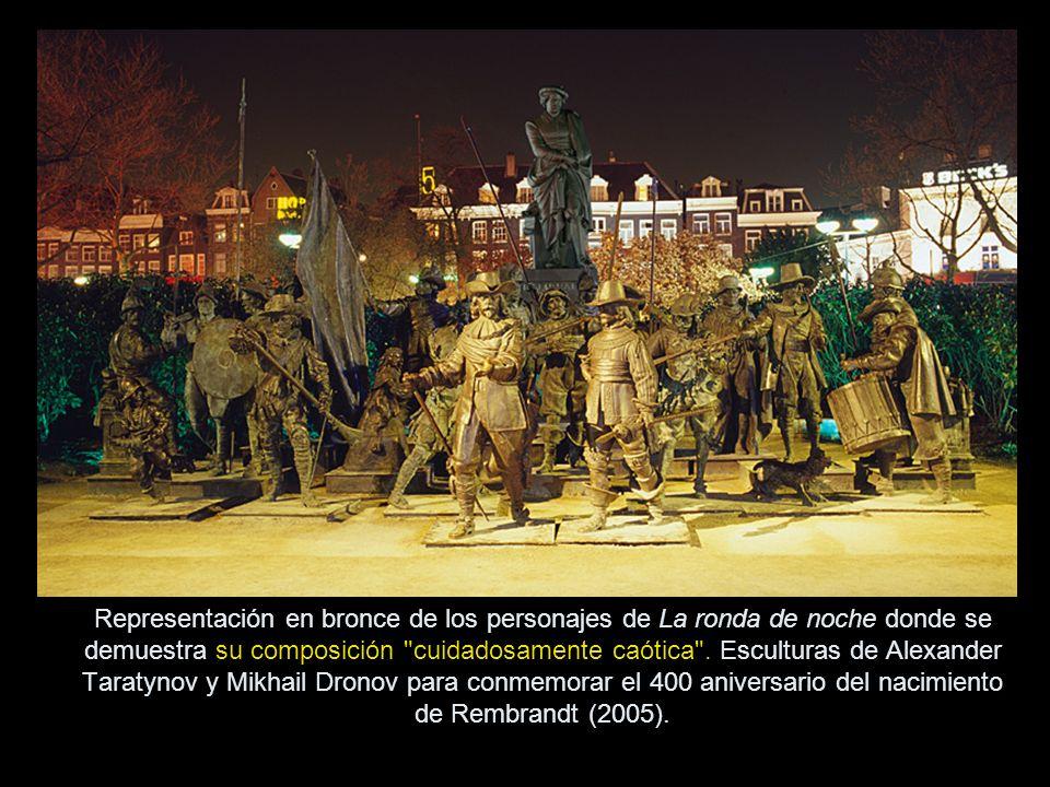 Representación en bronce de los personajes de La ronda de noche donde se demuestra su composición cuidadosamente caótica .
