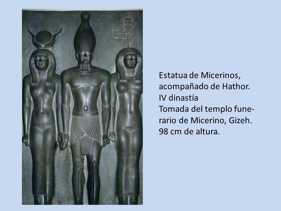 Estatua de Micerinos,acompañado de Hathor. IV dinastía. Tomada del templo fune- rario de Micerino, Gizeh.