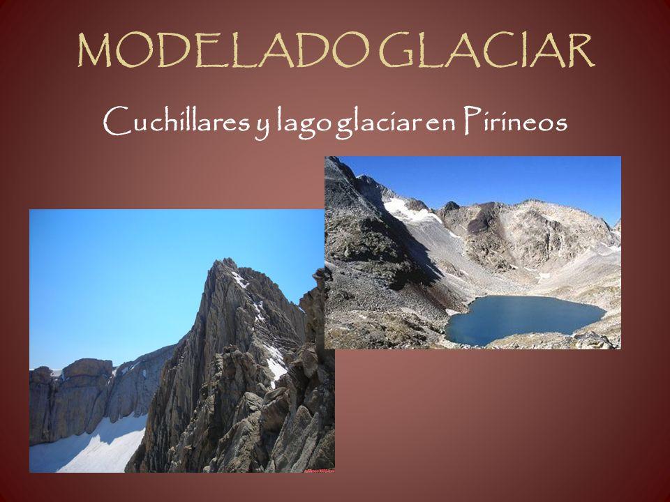 Cuchillares y lago glaciar en Pirineos