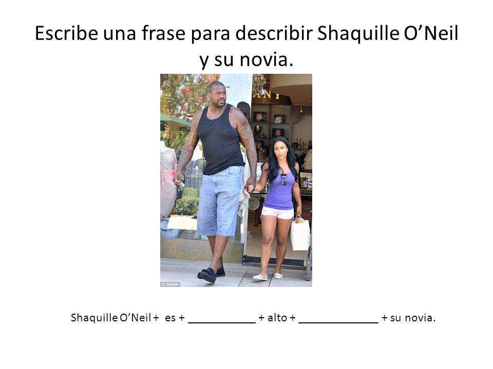 Escribe una frase para describir Shaquille O'Neil y su novia.