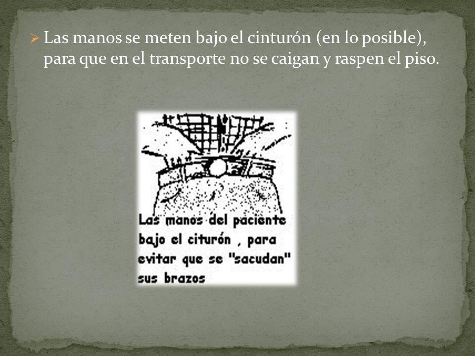 Las manos se meten bajo el cinturón (en lo posible), para que en el transporte no se caigan y raspen el piso.
