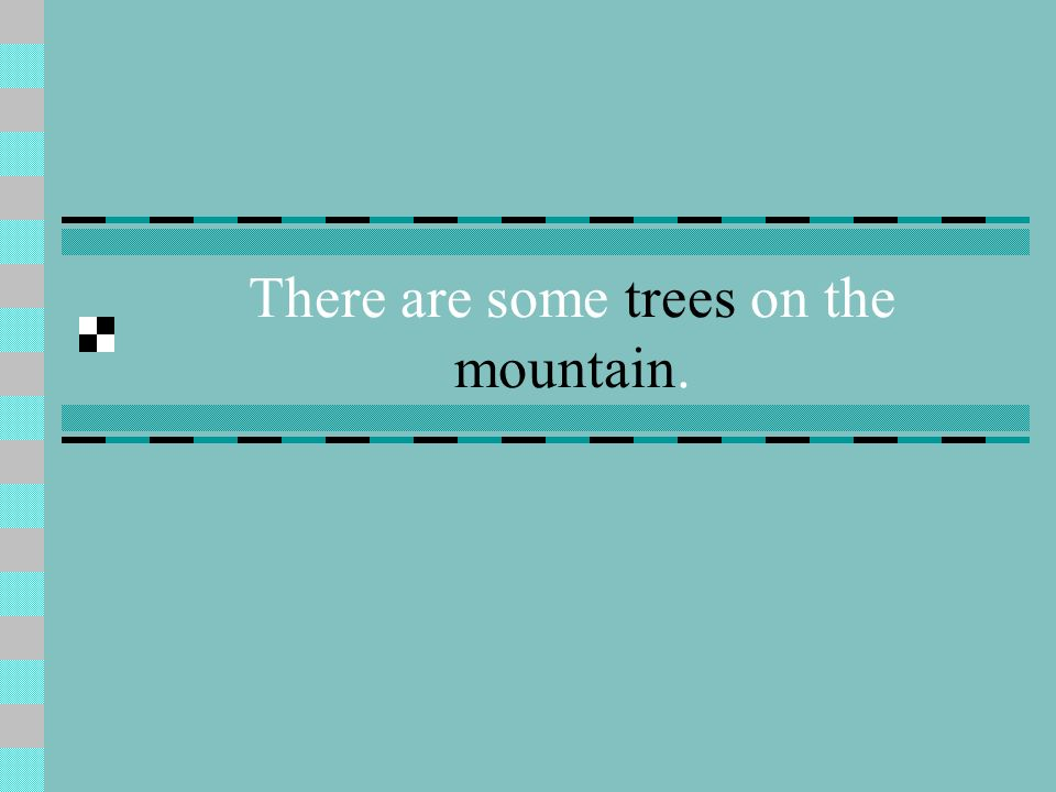 There are some trees on the mountain.