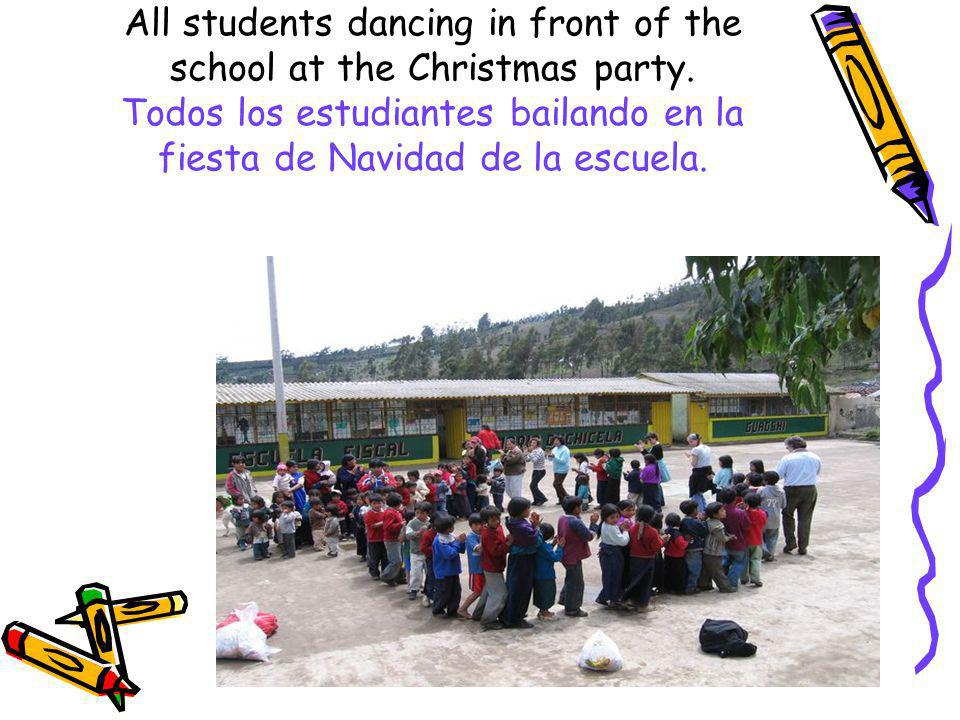 All students dancing in front of the school at the Christmas party