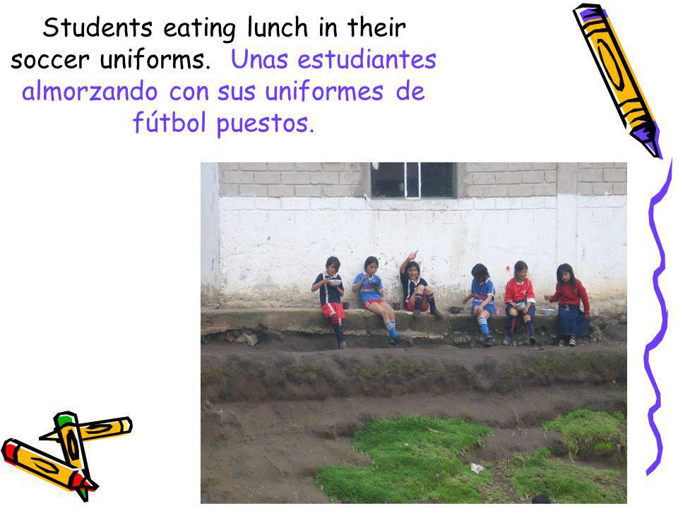 Students eating lunch in their soccer uniforms
