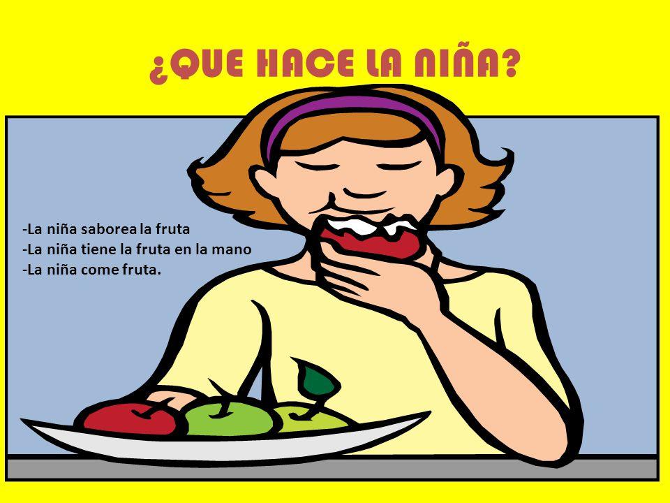 ¿QUE HACE LA NIÑA -La niña saborea la fruta