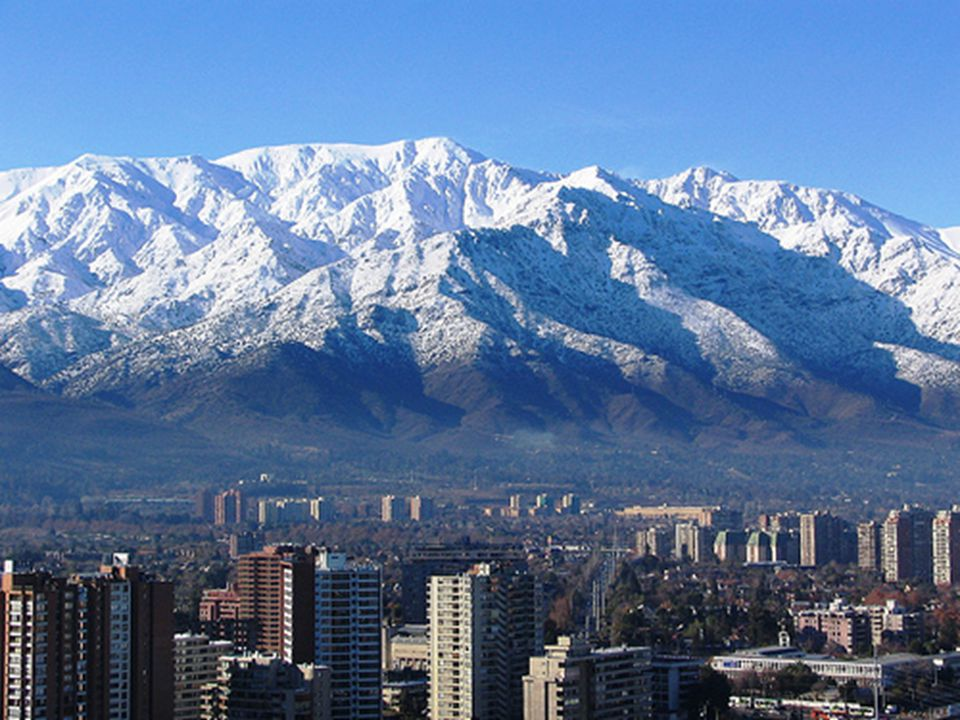 That is a nice view of Santiago on a winter day with the Andes mountain .