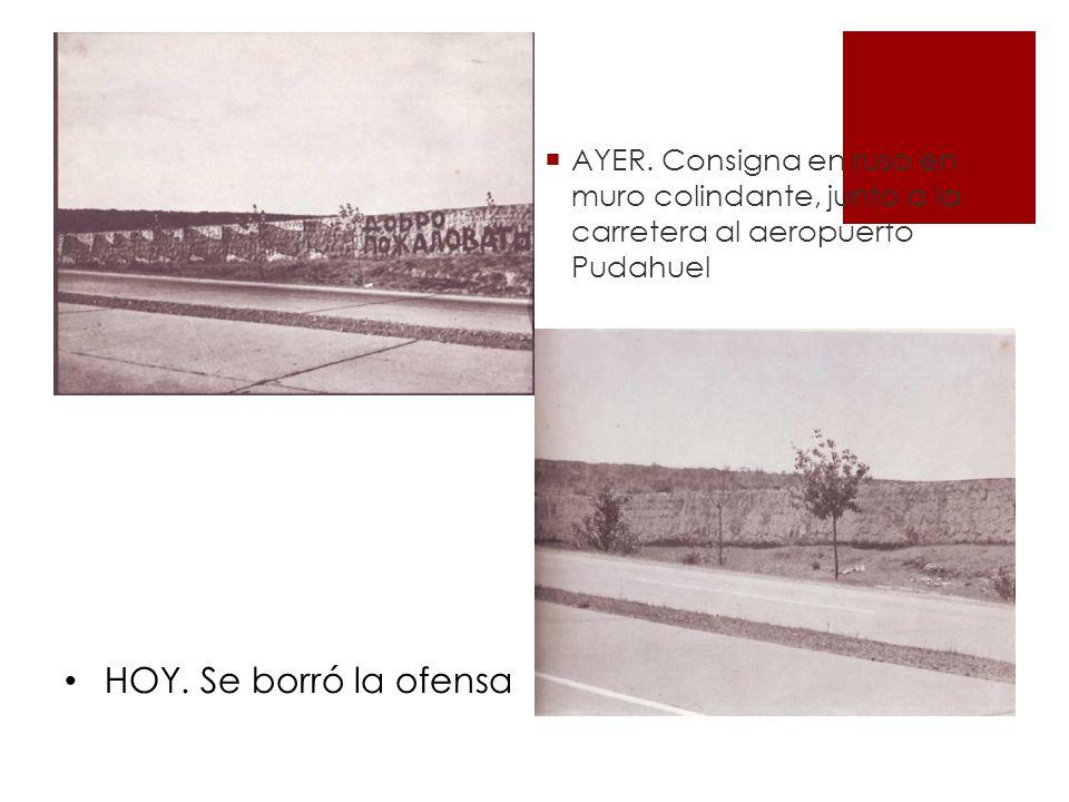 AYER. Consigna en ruso en muro colindante, junto a la carretera al aeropuerto Pudahuel