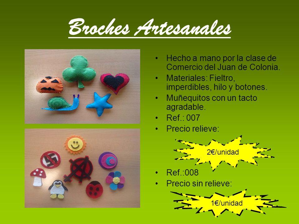 Broches Artesanales Hecho a mano por la clase de Comercio del Juan de Colonia. Materiales: Fieltro, imperdibles, hilo y botones.