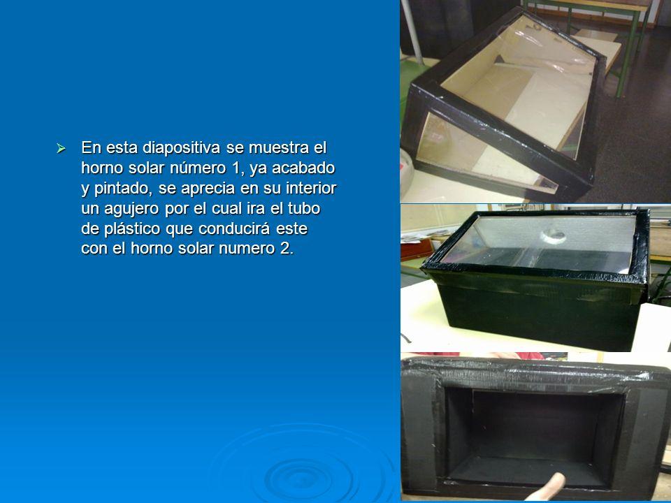 En esta diapositiva se muestra el horno solar número 1, ya acabado y pintado, se aprecia en su interior un agujero por el cual ira el tubo de plástico que conducirá este con el horno solar numero 2.