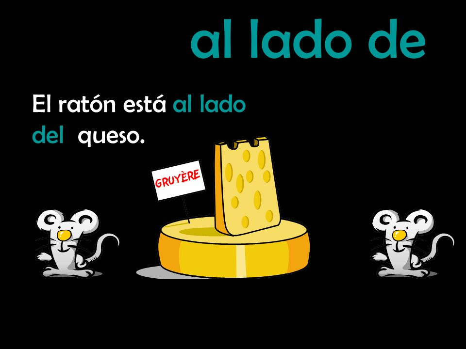 al lado de El ratón está al lado del queso.