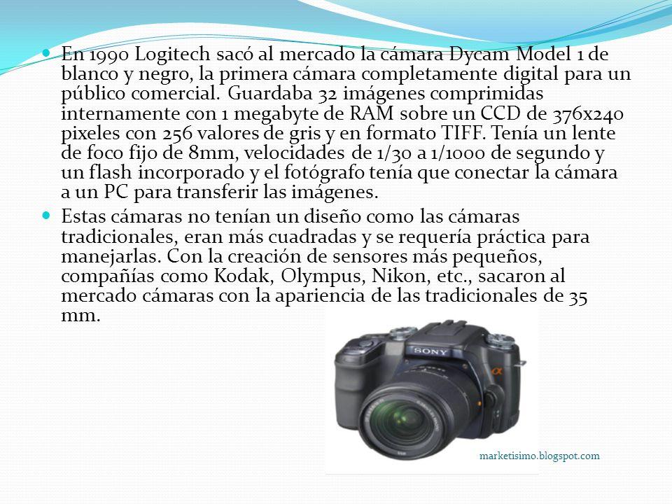 En 1990 Logitech sacó al mercado la cámara Dycam Model 1 de blanco y negro, la primera cámara completamente digital para un público comercial. Guardaba 32 imágenes comprimidas internamente con 1 megabyte de RAM sobre un CCD de 376x240 pixeles con 256 valores de gris y en formato TIFF. Tenía un lente de foco fijo de 8mm, velocidades de 1/30 a 1/1000 de segundo y un flash incorporado y el fotógrafo tenía que conectar la cámara a un PC para transferir las imágenes.