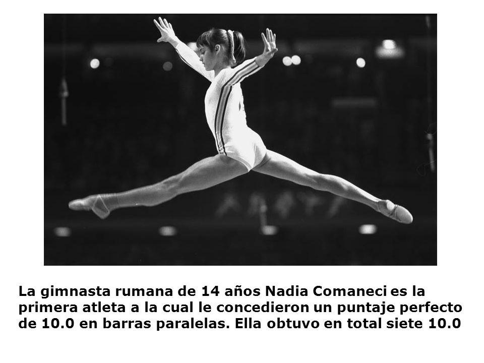 La gimnasta rumana de 14 años Nadia Comaneci es la primera atleta a la cual le concedieron un puntaje perfecto de 10.0 en barras paralelas.