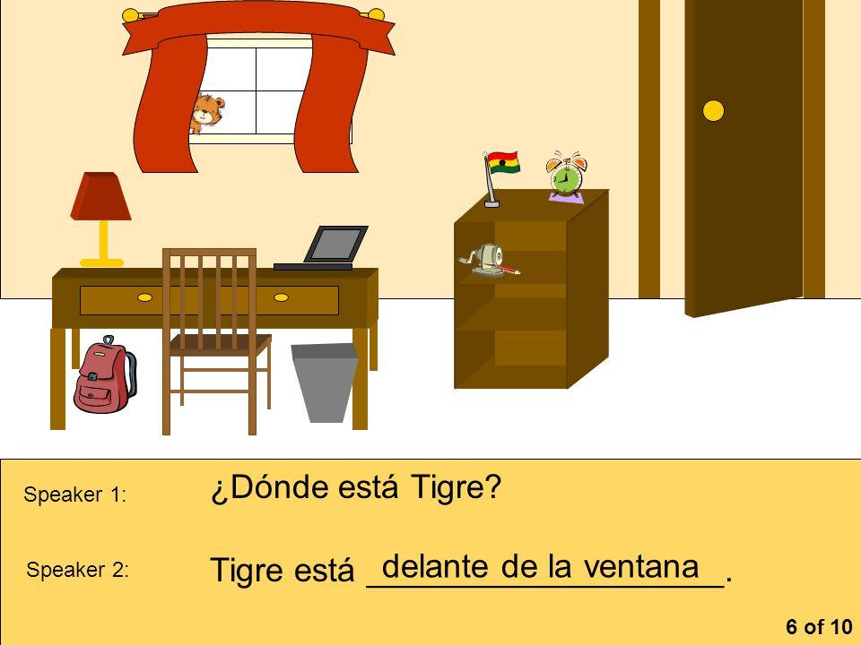 Tigre está ___________________. delante de la ventana